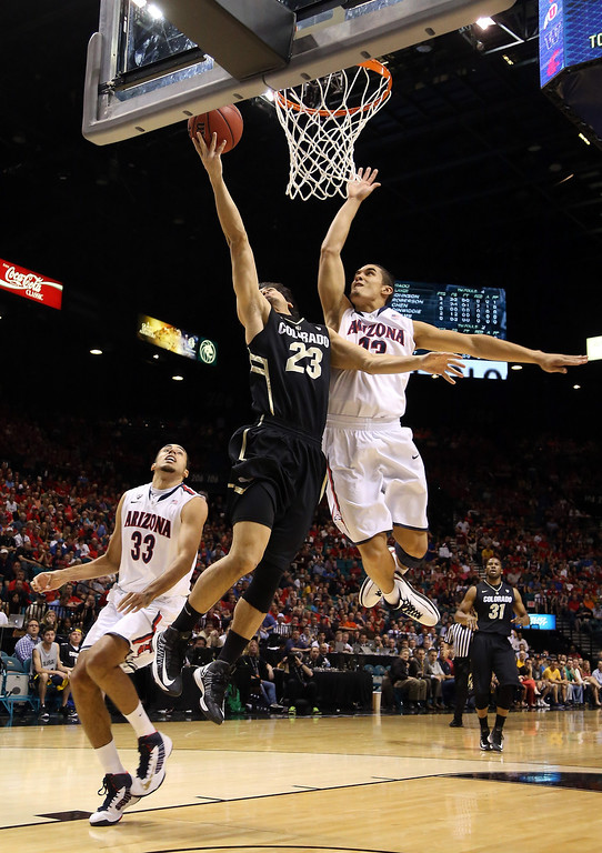 . Sabatino Chen #23 of the Colorado Buffaloes goes up for a shot against Nick Johnson #13 of the Arizona Wildcats in the first half during the quarterfinals of the Pac-12 tournament at the MGM Grand Garden Arena on March 14, 2013 in Las Vegas, Nevada.  (Photo by Jeff Gross/Getty Images)