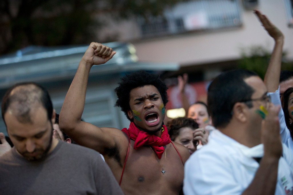 . A man shouts slogans during an anti-government protest in the Ipanema neighborhood, in Rio de Janeiro, Brazil, Friday, June 21, 2013.  (AP Photo/Silvia Izquierdo)