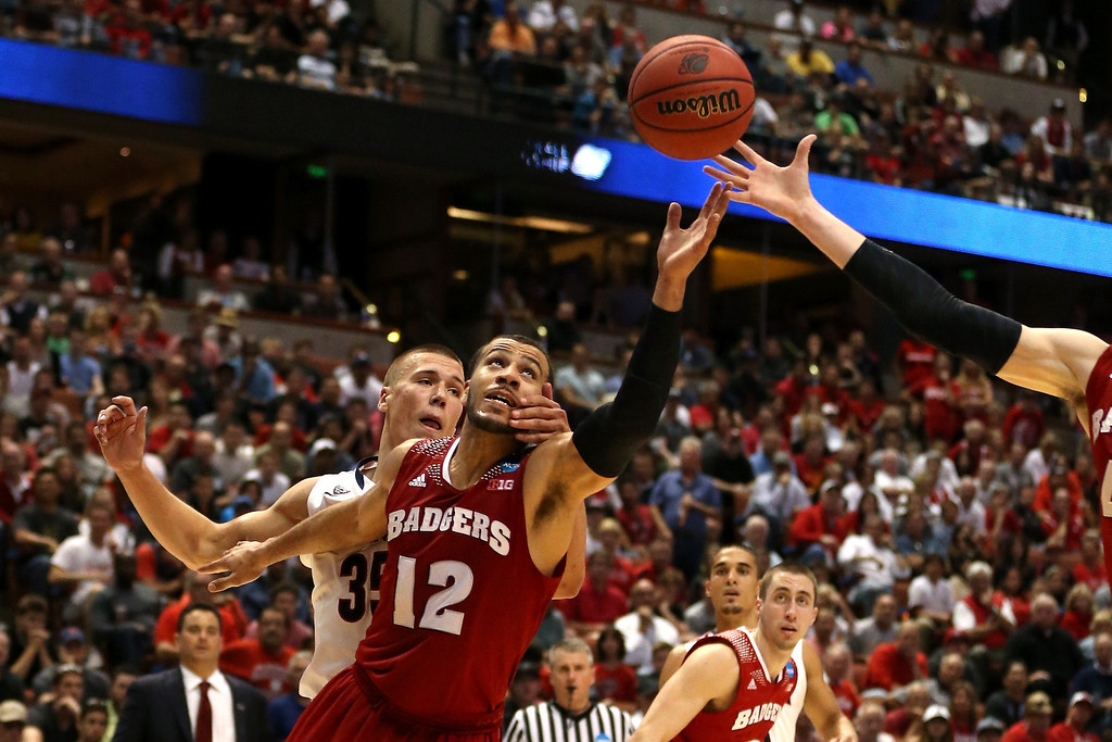 . Traevon Jackson #12 of the Wisconsin Badgers goes after the ball in front of Kaleb Tarczewski #35 of the Arizona Wildcats in the second half during the West Regional Final of the 2014 NCAA Men\'s Basketball Tournament at the Honda Center on March 29, 2014 in Anaheim, California.  (Photo by Jeff Gross/Getty Images)