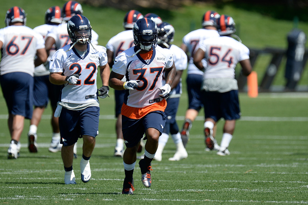 . Jacob Hester (22) and Jeremiah Johnson (37) of the Denver Broncos head to drills mini camp June 11, 2013 at Dove Valley. (Photo By John Leyba/The Denver Post)