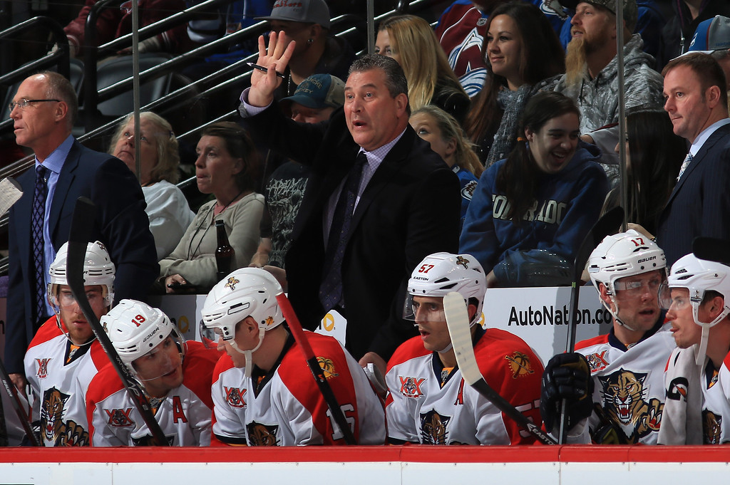 . DENVER, CO - NOVEMBER 16:  Head coach Peter Horachek (C) of the Florida Panthers directs the team as assistant coaches Brian Skrudland (L) and John Madden (R) look on against the Colorado Avalanche at Pepsi Center on November 16, 2013 in Denver, Colorado.  (Photo by Doug Pensinger/Getty Images)