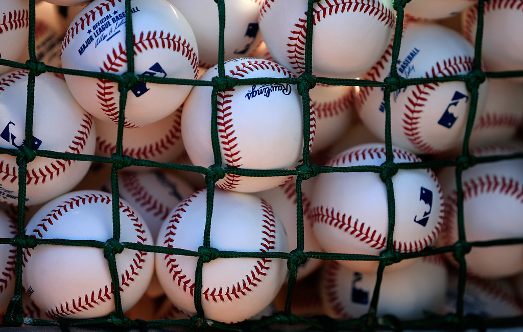 . Baseballs sit in a basket before the start of the Baltimore Orioles and Boston Red Sox Opening Day game at Oriole Park at Camden Yards on March 31, 2014 in Baltimore, Maryland.  (Photo by Rob Carr/Getty Images)