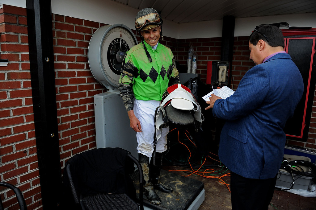 . BALTIMORE, MD - MAY 18:  John Bisono, jockey of Hello Lover gets weighed after winning the second race prior to the 138th running of the Preakness Stakes at Pimlico Race Course on May 18, 2013 in Baltimore, Maryland.  (Photo by Patrick Smith/Getty Images)