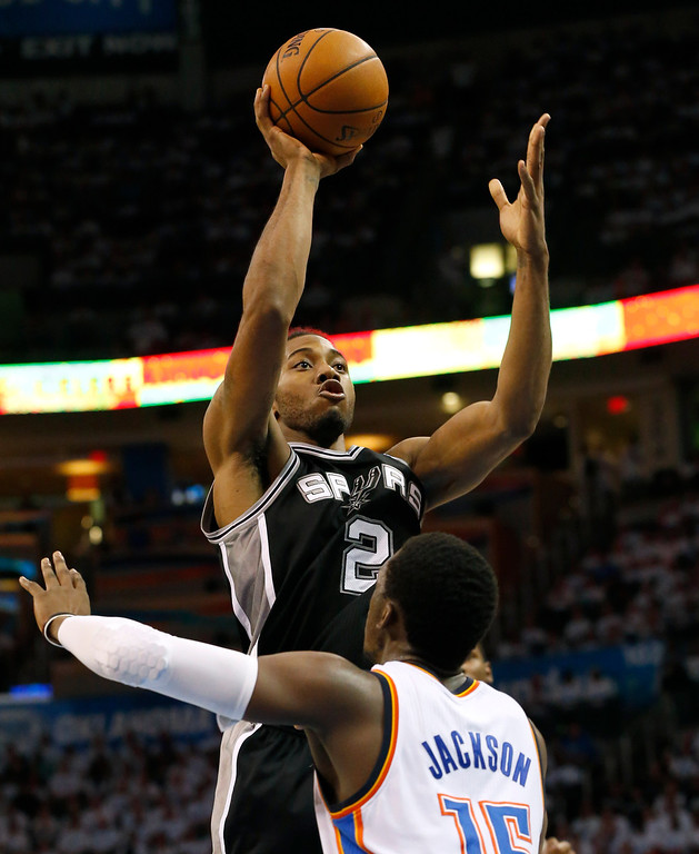 . San Antonio Spurs forward Kawhi Leonard (2) shoots over Oklahoma City Thunder guard Reggie Jackson (15) in the second half of Game 6 of the Western Conference finals NBA basketball playoff series in Oklahoma City, Saturday, May 31, 2014. (AP Photo/Sue Ogrocki)