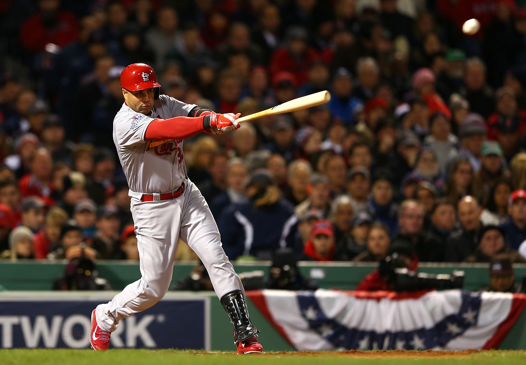 . BOSTON, MA - OCTOBER 24: Carlos Beltran #3 of the St. Louis Cardinals hits an RBI single in the seventh inning against the Boston Red Sox during Game Two of the 2013 World Series at Fenway Park on October 24, 2013 in Boston, Massachusetts.  (Photo by Elsa/Getty Images)
