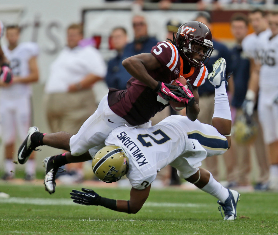 . Virginia Tech wide receiver Joshua Stanford (5) gets knocked down by Pittsburgh defensive back K\'Waun Williams (2) during the second half of an NCAA college football game in Blacksburg, Va., Saturday, Oct. 12, 2013. Virginia Tech won the game 19-9.   (AP Photo/Steve Helber)