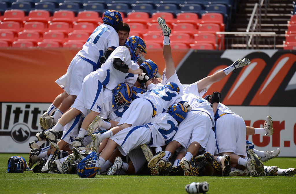 . DENVER, CO. - MAY 18 : Wheat Ridge High School players celebrate winning of 4A Boy\'s Lacrosse Championship game against Air Academy High School at Sports Authority Field at Mile High Stadium. Denver, Colorado. May 18, 2013. Wheat Ridge won 14-2. (Photo By Hyoung Chang/The Denver Post)