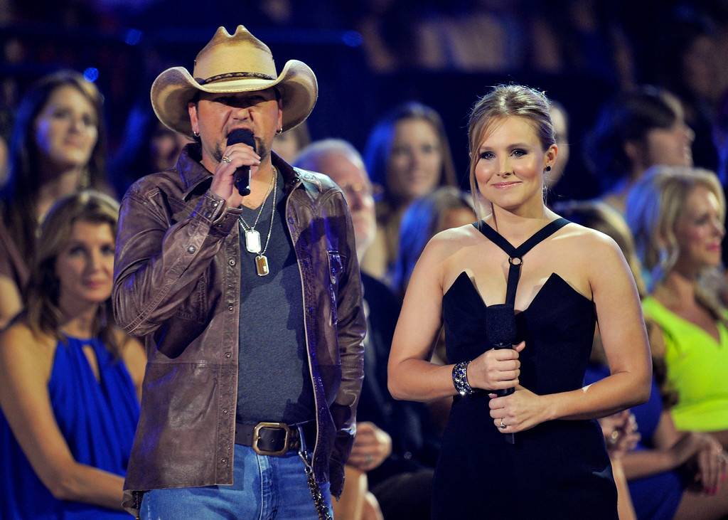 . Jason Aldean, left, and Kristen Bell speak in the audience at the 2013 CMT Music Awards at Bridgestone Arena on Wednesday, June 5, 2013, in Nashville, Tenn. (Photo by Donn Jones/Invision/AP)