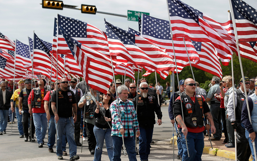 . Members of the Patriot Guard line the road for  a procession prior to a memorial service for first responders who died in last week\'s fertilizer plant explosion in West, Texas, Thursday, April 25, 2013, in Waco, Texas. (AP Photo/Eric Gay)