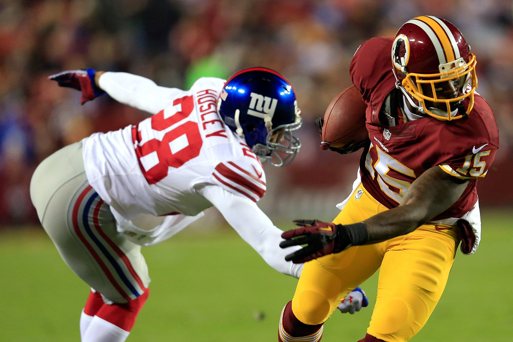 . Josh Morgan #15 of the Washington Redskins runs the ball against Jayron Hosley #28 of the New York Giants in the first quarter during their game at FedExField on December 1, 2013 in Landover, Maryland.  (Photo by Rob Carr/Getty Images)