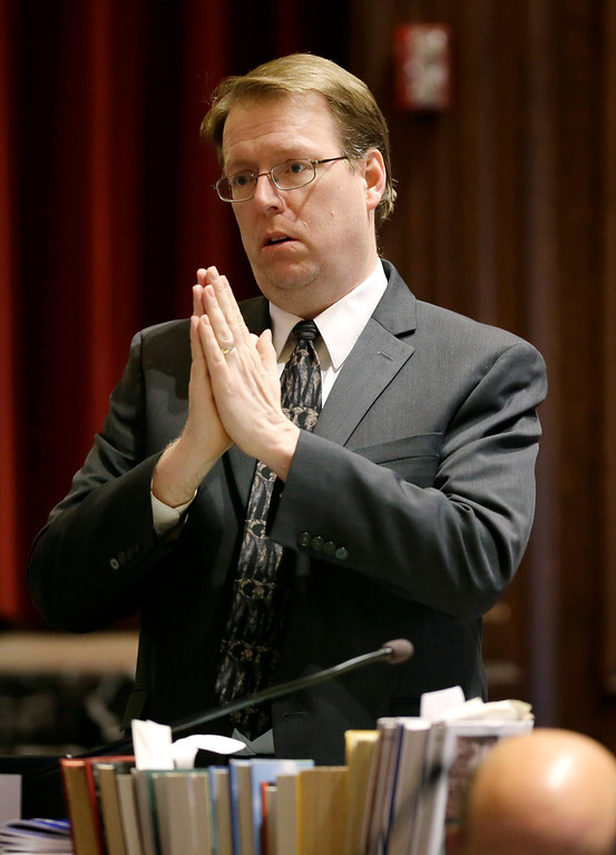 . Sen. Robert Hogg, D-Cedar Rapids, gestures before the opening prayer on the floor of the Senate, Thursday, May 1, 2014, at the Statehouse in Des Moines, Iowa. The Iowa Senate, after working all night to finish the 2014 legislative session, must return for one more day after a dispute developed involving subpoena powers. (AP Photo/Charlie Neibergall)