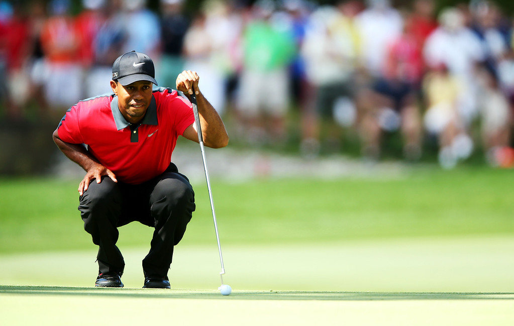 . Tiger Woods of the United States lines up his putt on the first green during the final round of the 95th PGA Championship on August 11, 2013 in Rochester, New York.  (Photo by Andrew Redington/Getty Images)