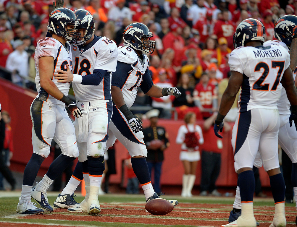 . Denver Broncos quarterback Peyton Manning (18) congratulates Denver Broncos wide receiver Eric Decker (87) on his touchdown catch in the second quarter agains the Kansas City Chiefs December 1, 2013 at Arrowhead Stadium.  (Photo by John Leyba/The Denver Post)