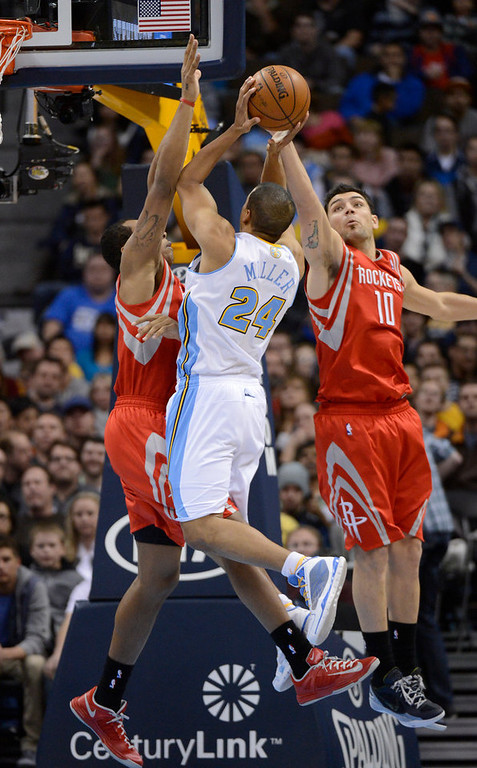 . DENVER, CO. - JANUARY 30: Denver Nuggets point guard Andre Miller (24) gets double teamed by Houston Rockets power forward Greg Smith (4) and Carlos Delfino (10) during the third quarter January 30, 2013 at Pepsi Center. The Denver Nuggets take on the Houston Rockets in NBA action. (Photo By John Leyba/The Denver Post)