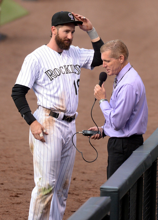 . DENVER, CO - APRIL 4:  Colorado outfielder Charlie Blackmon finished a radio interview after his amazing 6-6 day Friday. The Colorado Rockies defeated the Arizona Diamondbacks 12-2 on opening day at Coors Field Friday afternoon, April 4, 2014 in Denver. (Photo by Karl Gehring/The Denver Post)