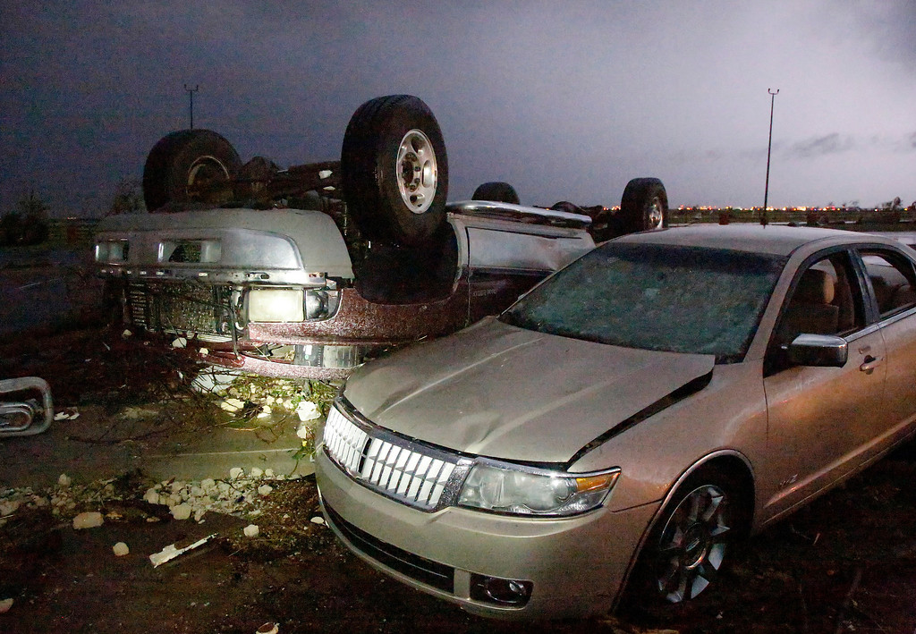 . Cars that were damaged by a tornado in parking lot at Canadian Valley Technical Center on State Highway 66, west of Banner Road, Friday May 31, 2013 in El Reno, Okla. (AP Photo/The Oklahoman, Jim Beckel)