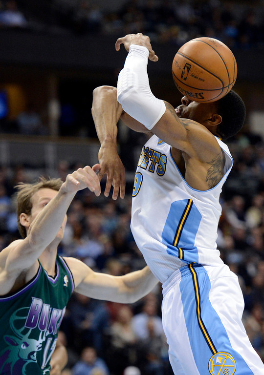 . DENVER, CO. - FEBRUARY 05: Andre Iguodala (9) of the Denver Nuggets gets the ball knocked out of his hand by Mike Dunleavy (17) of the Milwaukee Bucks during the first quarter February 05, 2013 at Pepsi Center. The Denver Nuggets take on the Milwaukee Bucks in NBA action. (Photo By John Leyba/The Denver Post)
