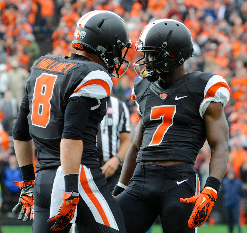 . Oregon State\'s Brandin Cooks (7) celebrates his catch against Colorado with Richard Mullaney (8) in the first half of an NCAA college football game in Corvallis, Ore., Saturday, Sept 28, 2013. (AP Photo/Greg Wahl-Stephens)