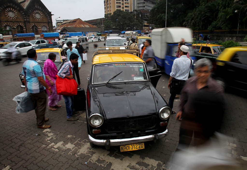 . In this Wednesday, July 31, 2013, a Mumbai Premier Padmini taxi waits for customers in Mumbai, India. More than 4500 Premier Padmini taxis are expected to be banned from the roads in Mumbai this year, starting in August,  in line with a government order that bans cabs that are more than 20 years old. (AP Photo/Rafiq Maqbool)