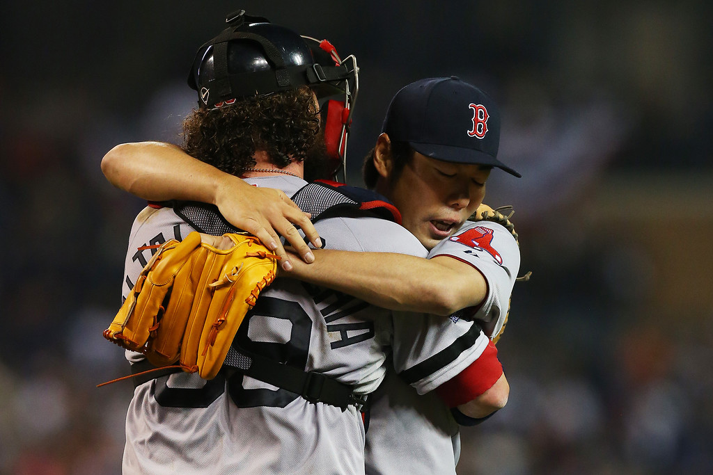 . Koji Uehara #19 celebrates with Jarrod Saltalamacchia #39 of the Boston Red Sox after their 1 to 0 win over the Detroit Tigers during Game Three of the American League Championship Series at Comerica Park on October 15, 2013 in Detroit, Michigan.  (Photo by Ronald Martinez/Getty Images)