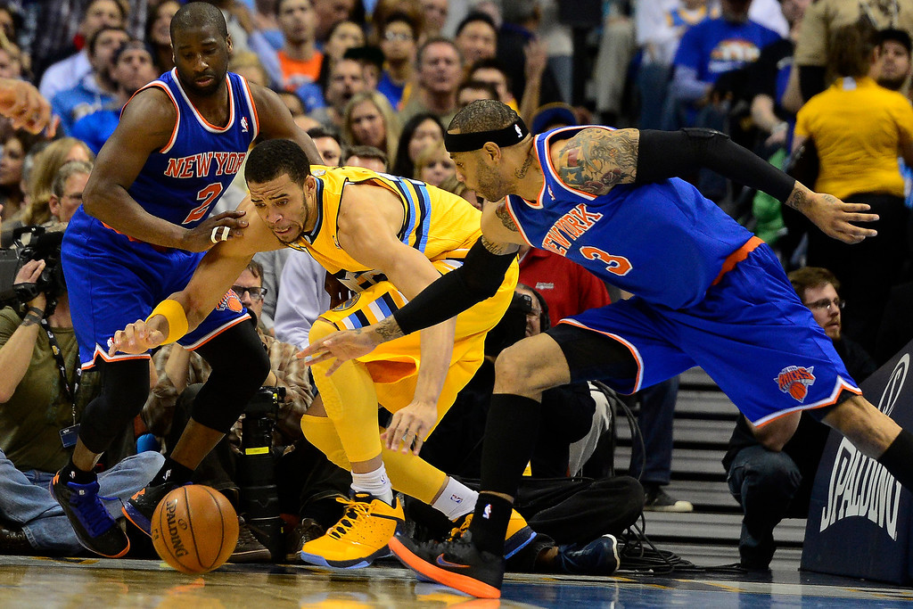 . DENVER, CO - MARCH 13: JaVale McGee (34) of the Denver Nuggets goes for a loose ball against Raymond Felton (2) of the New York Knicks and Kenyon Martin during the first half of action. The Denver Nuggets play the New York Knicks at the Pepsi Center. (Photo by AAron Ontiveroz/The Denver Post)