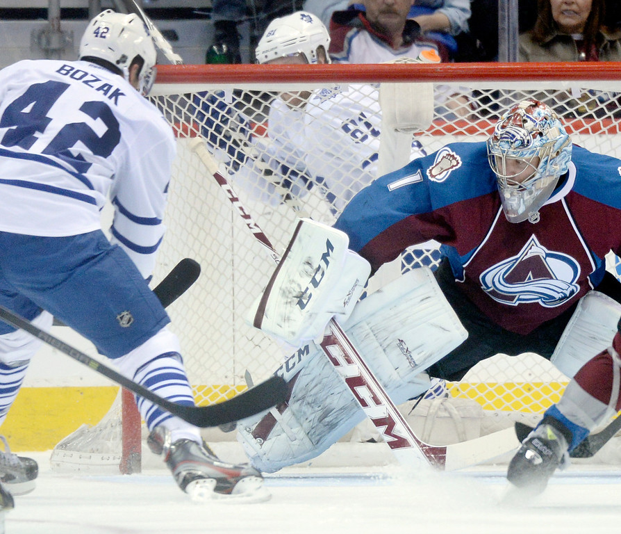 . DENVER, CO. - JANUARY 21:  Toronto center Tyler Bozak (42) pressured Colorado goaltender Semyon Varlamov (1) in the first period. The Colorado Avalanche hosted the Toronto Maple Leafs Tuesday night, January 21, 2014 at the Pepsi Center. Photo By Karl Gehring/The Denver Post