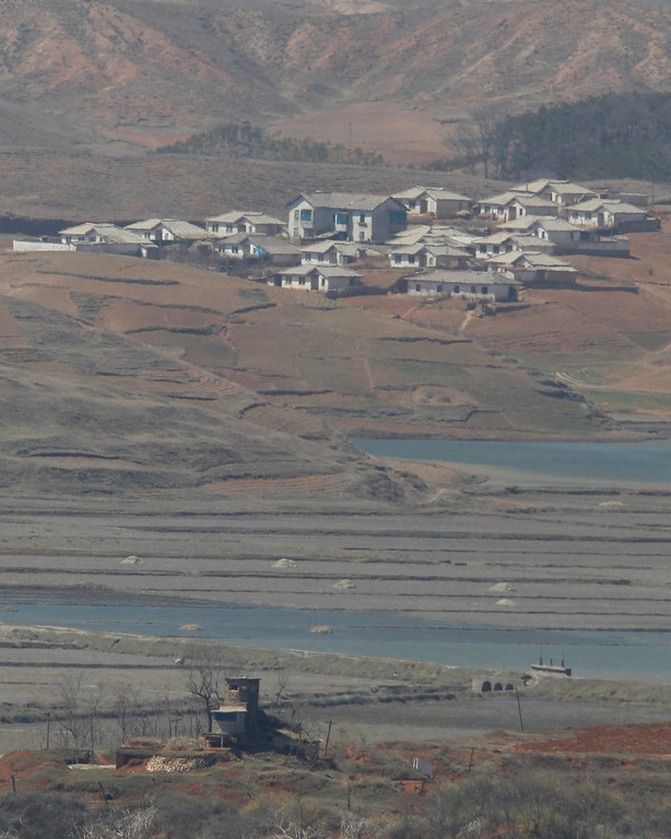 . A North Korean guard post (bottom) in the propaganda village of Gijeongdong is seen in this picture taken from a South Korean observation post, just south of the demilitarized zone separating the two Koreas, in Paju, north of Seoul April 14, 2013. The United States said on Saturday that China had agreed to help rid North Korea of its nuclear capability by peaceful means, but Beijing made no specific commitment in public to pressure its long-time ally to change its ways.   REUTERS/Kim Hong-Ji