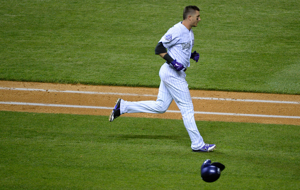 . Troy Tulowitzki (2) of the Colorado Rockies slams his helmet down after flying out to Gregor Blanco (7) of the San Francisco Giants during the seventh inning May 16, 2013 at Coors Field. (Photo By John Leyba/The Denver Post)