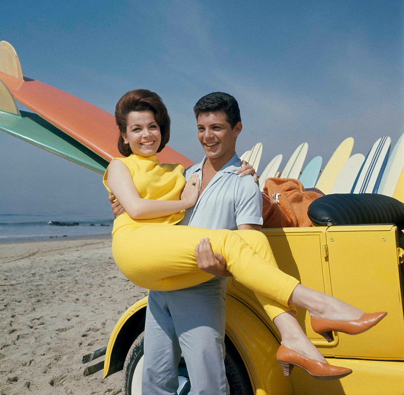 ". Singer Frankie Avalon with actress Annette Funicello on Malibu Beach, during filming of  ""Beauty Party,\"" in California in 1963. (AP Photo)"