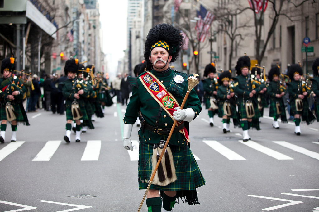 . A pipes and drums band marches on Fifth Avenue during the 252nd annual St. Patrick\'s Day Parade March 16, 2013 in New York City. The parade honors the patron saint of Ireland and was held for the first time in New York on March 17, 1762, 14 years before the signing of the Declaration of Independence. (Photo by Ramin Talaie/Getty Images)