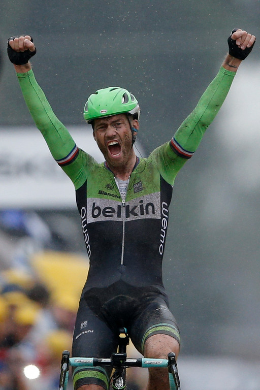 . Netherlands\'s Lars Boom crosses the finish line to win the fifth stage of the Tour de France cycling race over 155 kilometers (96.3 miles) with start in Ypres, Belgium, and finish in Arenberg, France, Wednesday, July 9, 2014. (AP Photo/Peter Dejong)
