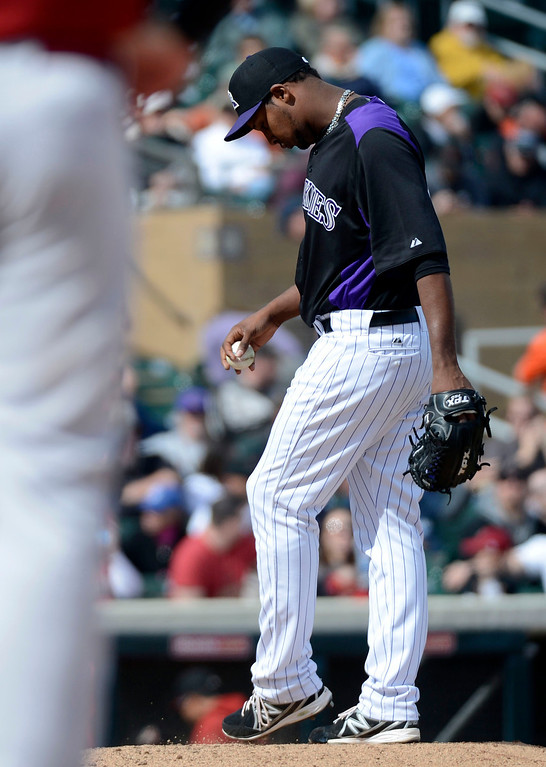 . SCOTTSDALE, AZ. - FEBRUARY 24: Juan Nicasio (44) of the Colorado Rockies stands dejected on the mound as manager Walt Weiss heads to the mound to relive him in the fourth inning against the Arizona Diamondbacks February 24, 2013 in Scottsdale. (Photo By John Leyba/The Denver Post)