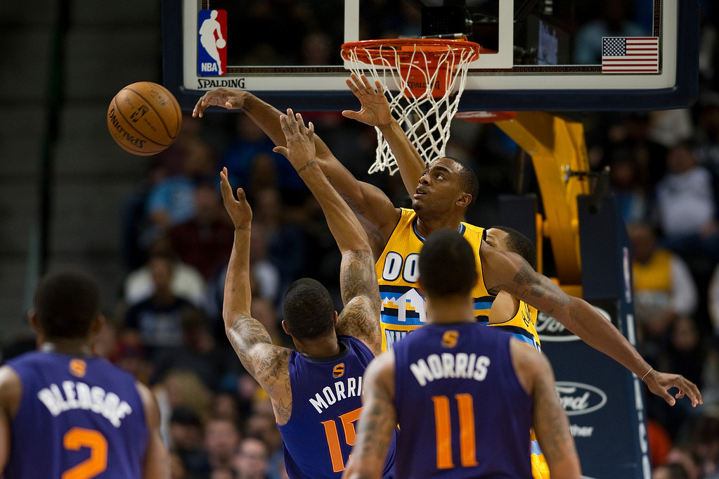 . DENVER, CO - DECEMBER 20: Darrell Arthur #00 of the Denver Nuggets blocks a shot by Marcus Morris #15 of the Phoenix Suns during an NBA game at the Pepsi Center on December 20, 2013, in Denver, Colorado. (Photo by Daniel Petty/The Denver Post)