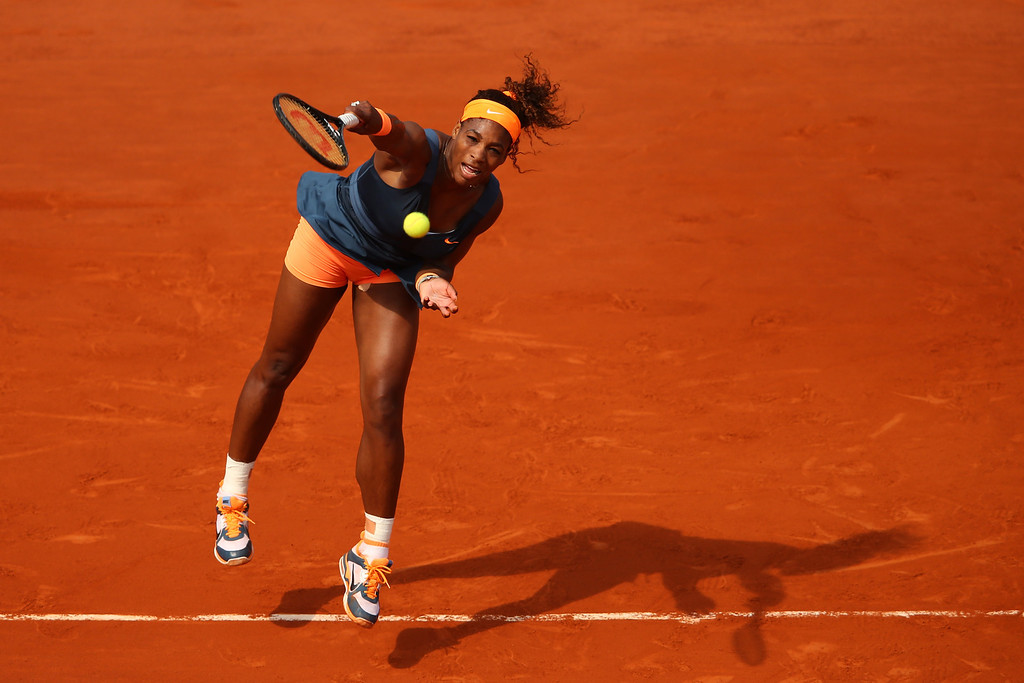 . Serena Williams of United States of America serves in her Women\'s Singles Final match against Maria Sharapova of Russia  during day fourteen of French Open at Roland Garros on June 8, 2013 in Paris, France.  (Photo by Julian Finney/Getty Images)