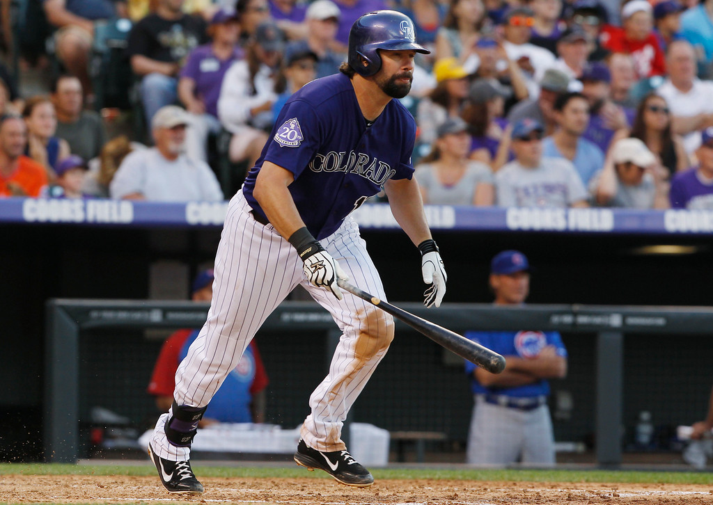 . Colorado Rockies\' Todd Helton follows the flight of his single against the Chicago Cubs in the fourth inning of a baseball game in Denver on Saturday, July 20, 2013, in Denver. (AP Photo/David Zalubowski)