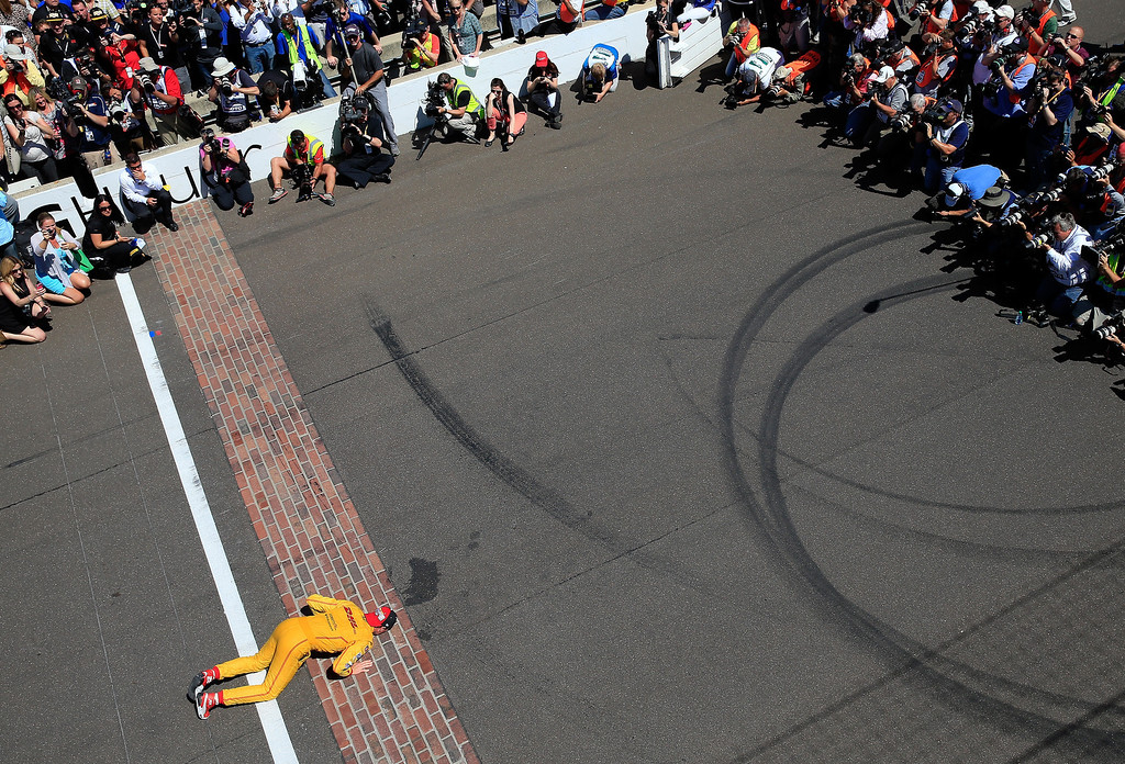 . Ryan Hunter-Reay, driver of the #28 Andretti Autosport DHL Honda, kisses the bricks at the finish line after winning the 98th running of the Indianapolis 500 Mile Race at Indianapolis Motorspeedway on May 25, 2014 in Indianapolis, Indiana.  (Photo by Jamie Squire/Getty Images)