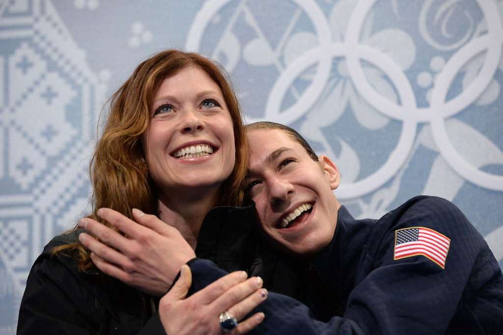 . US Jason Brown and coach Kori Ade celebrate in the kiss and cry zone after the Men\'s Figure Skating Short Program at the Iceberg Skating Palace during the Sochi Winter Olympics on February 13, 2014.  YURI KADOBNOV/AFP/Getty Images