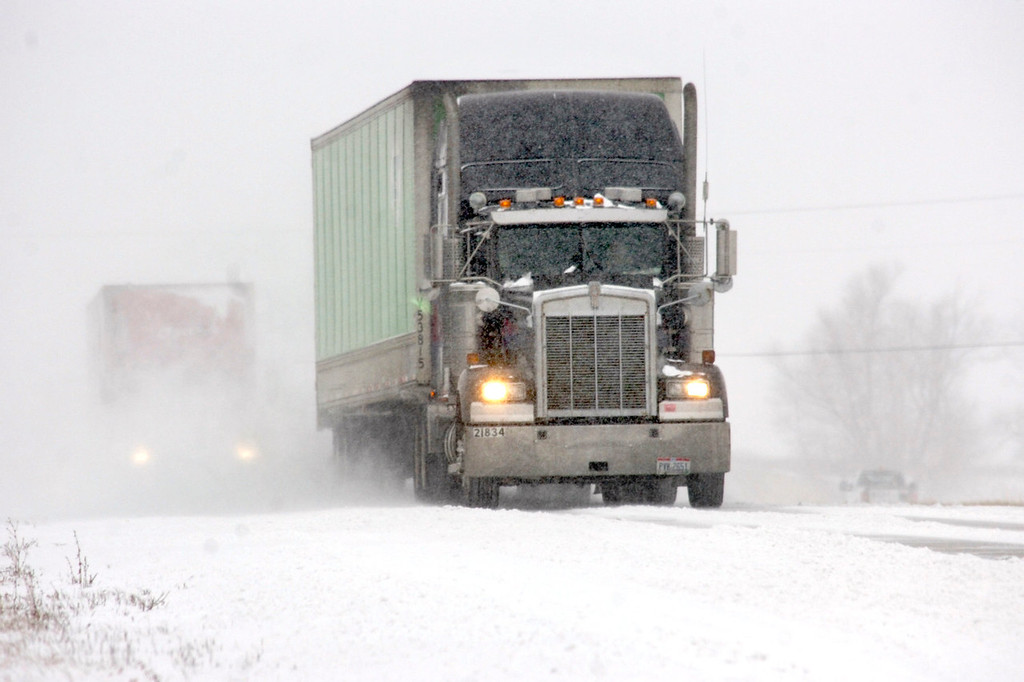. Drivers cope with falling and blowing snow on state highway 18 east of Marion, Ind., on Thursday, Jan. 2, 2014. Most of Indiana was under a winter weather advisory Thursday from the National Weather Service.  (AP Photo/The Chronicle-Tribune, Jeff Morehead)