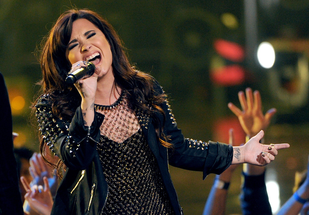 """. LOS ANGELES, CA - DECEMBER 16:  Singer Demi Lovato performs onstage during \""""VH1 Divas\"""" 2012 at The Shrine Auditorium on December 16, 2012 in Los Angeles, California.  (Photo by Kevin Winter/Getty Images)"""