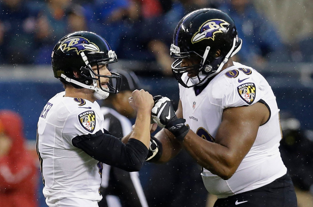 . Baltimore Ravens kicker Justin Tucker (9) celebrates his 52-yard field goal with Eugene Monroe (60) during the first half of an NFL football game against the Chicago Bears, Sunday, Nov. 17, 2013, in Chicago. (AP Photo/Nam Y. Huh)