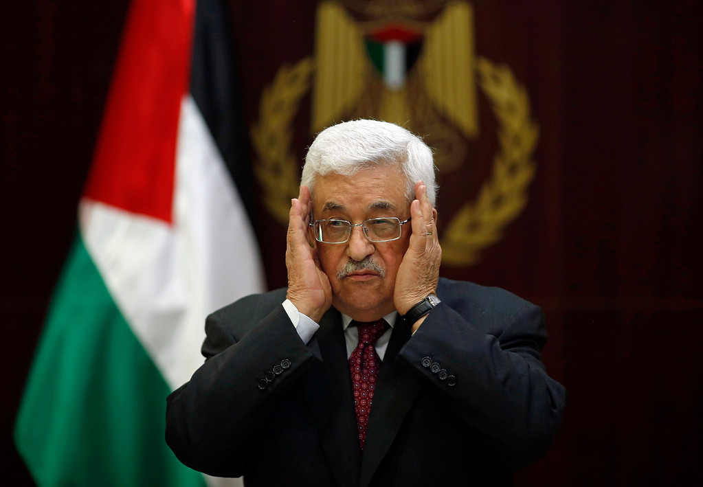. Palestinian President Mahmoud Abbas prays for Maysara Abu Hamdeya, a Palestinian inmate who died from cancer in an Israeli hospital on Tuesday, during a Fatah Central Committee meeting in the West Bank city of Ramallah April 2, 2013. Hamdeya\'s death threatened to raise tensions in the Israeli-occupied West Bank, where Palestinians, who view jailed brethren as heroes in a fight for statehood, have held several protests in recent weeks in support of prisoners. REUTERS/Mohamed Torokman