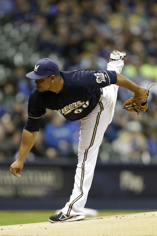 . MILWAUKEE, WI - APRIL 3:  Wily Peralta #60 of the Milwaukee Brewers pitches in the top of the first inning against the Colorado Rockies during the game at Miller Park on April 3, 2013 in Milwaukee, Wisconsin.  (Photo by Mike McGinnis/Getty Images)