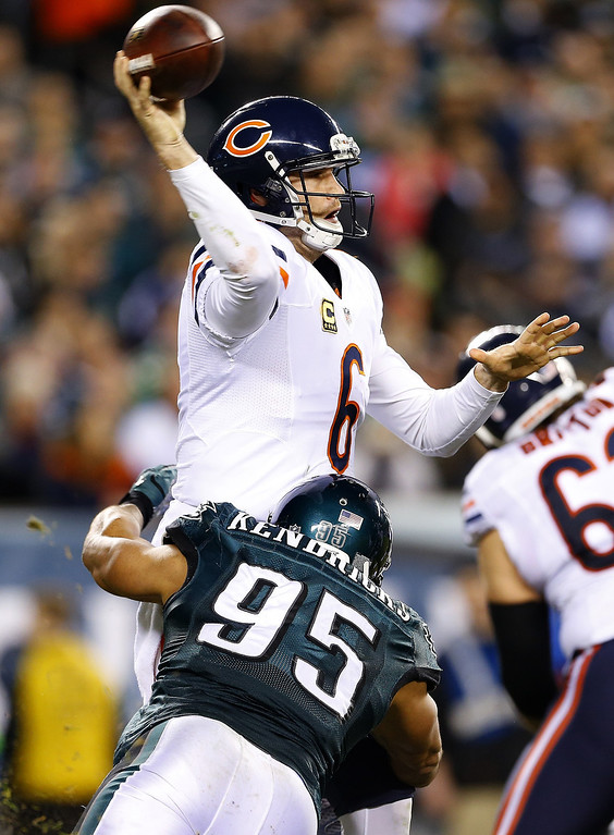. Quarterback Jay Cutler #6 passes the ball as linebacker Mychal Kendricks #95 of the Philadelphia Eagles tackles him in the second quarter during a game at Lincoln Financial Field on December 22, 2013 in Philadelphia, Pennsylvania. (Photo by Rich Schultz /Getty Images)