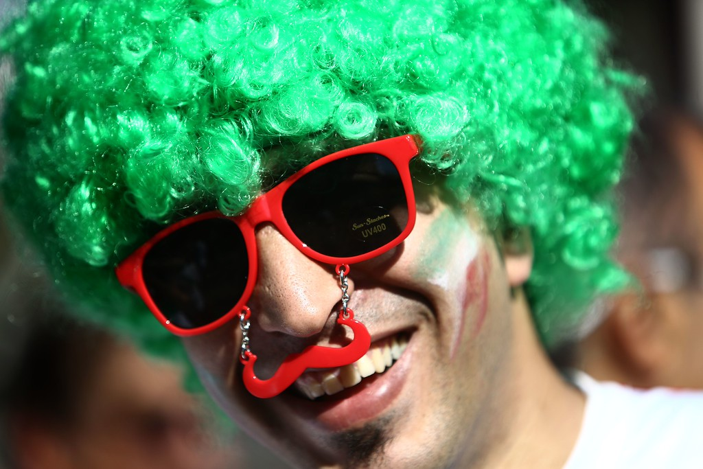 . An Iranian fan cheers outside Baixada Arena in Curitiba on June 16, 2014, before the 2014 FIFA World Cup Group F football match between Iran and Nigeria. AFP PHOTO / BEHROUZ  MEHRI/AFP/Getty Images