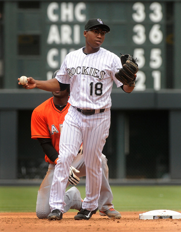 . Rockies infielder Jonathan Herrera made the force out on Miami baserunner Adeiny Hechavarria in the third inning. The Colorado Rockies hosted the Miami Marlins at Coors Field Thursday afternoon, July 25, 2013. Photo By Karl Gehring/The Denver Post