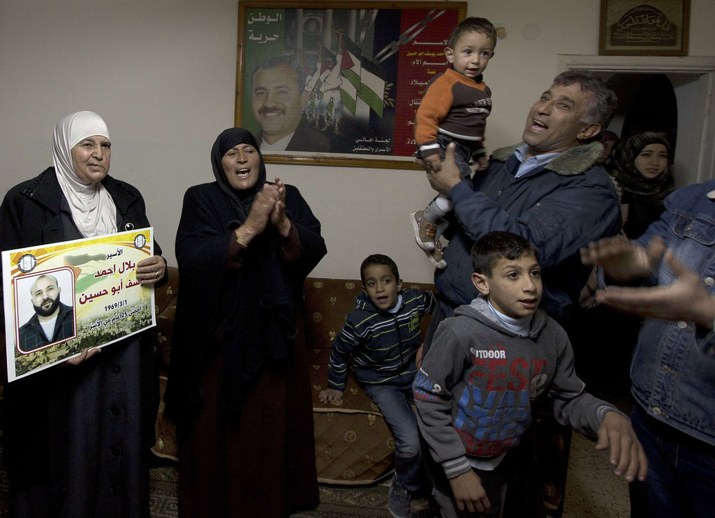 . Friends and relatives of Palestinian prisoner Bilal abu Hussein  dance as they celebrate after receiving the news of his impending release, at his family house in East Jerusalem on December 29, 2013. Israel prepared today to free 26 Palestinian prisoners as part of peace talks brokered by US Secretary of State John Kerry, who is due back in the region to boost the faltering negotiations.  AHMAD GHARABLI/AFP/Getty Images