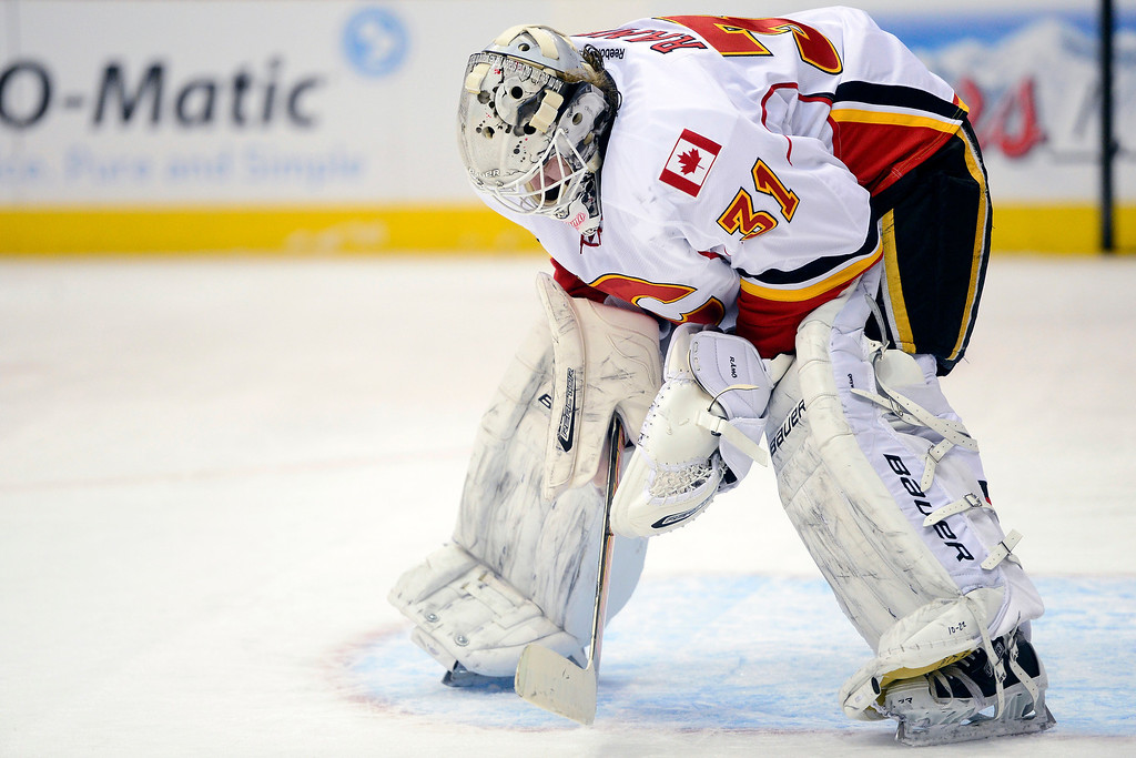 . Karri Ramo (31) of the Calgary Flames takes a breather against the Colorado Avalanche during the first period.   (Photo by AAron Ontiveroz/The Denver Post)