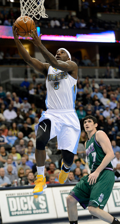 . DENVER, CO. - FEBRUARY 05: Ty Lawson (3) of the Denver Nuggets flies past Ersan Ilyasova (7) of the Milwaukee Bucks for a basket during the first quarter February 05, 2013 at Pepsi Center. The Denver Nuggets take on the Milwaukee Bucks in NBA action. (Photo By John Leyba/The Denver Post)