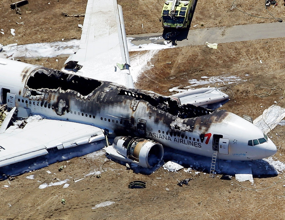 . This aerial photo shows the wreckage of the Asiana Flight 214 airplane after it crashed at the San Francisco International Airport in San Francisco, Saturday,  July 6, 2013. (AP Photo/Marcio Jose Sanchez)