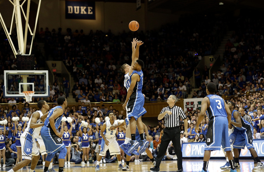 . Duke Blue team\'s Jabari Parker and White team\'s Marshall Plumlee (40) jump for the tipoff to start the Blue-White scrimmage during the team\'s Countdown to Craziness NCAA college basketball preseason event in Durham, N.C., Friday, Oct. 18, 2013. (AP Photo/Gerry Broome)